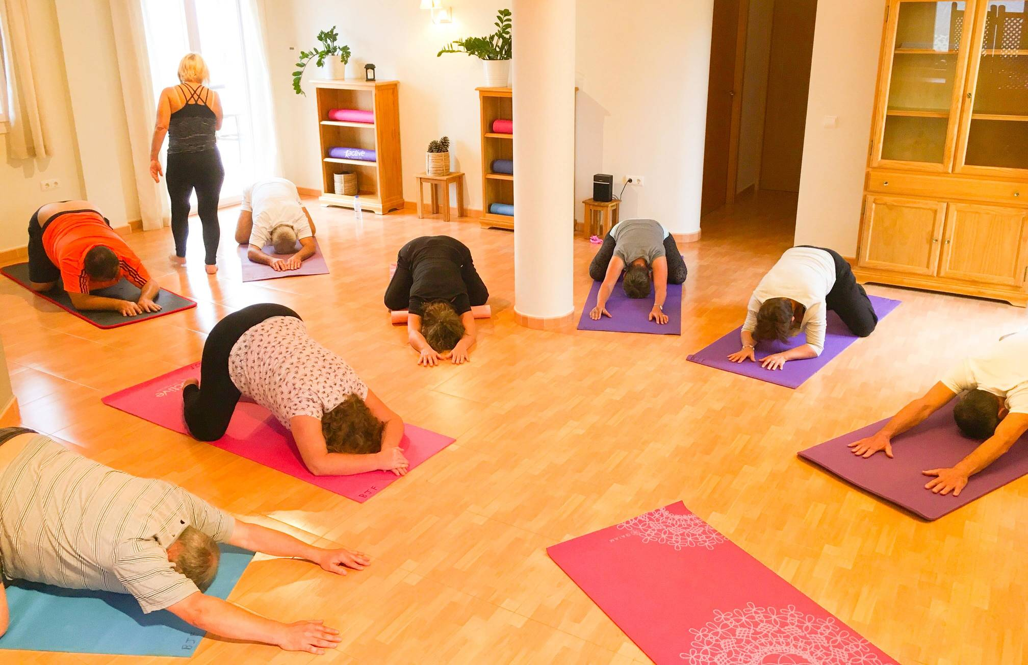 rsz_yoga_room_students_practising_puppy_pose