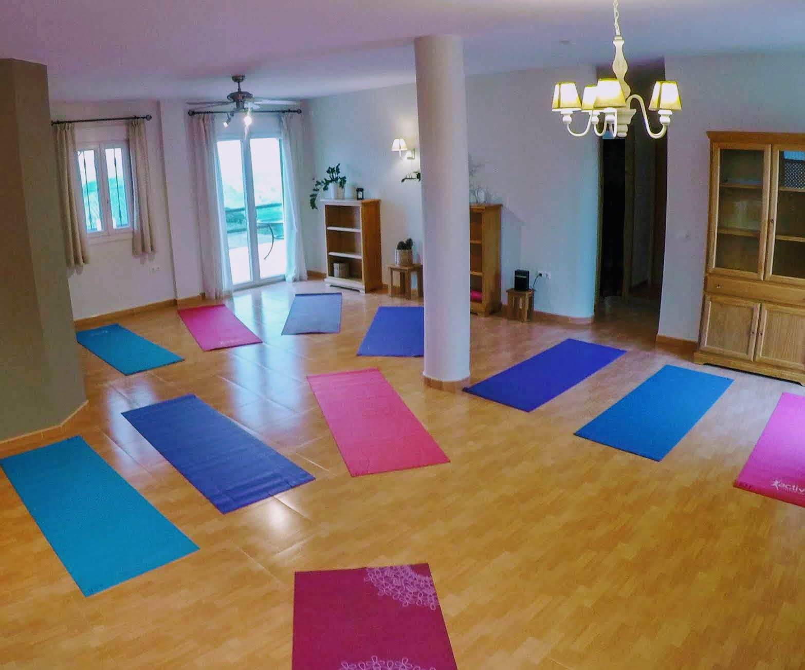 yoga room empty with mats terrace view